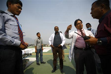 Doctors expecting the arrival of the victims of a Mount Everest avalanche standby near the helipad at Grandi International Hospital in Kathmandu April 18, 2014. REUTERS/Navesh Chitrakar