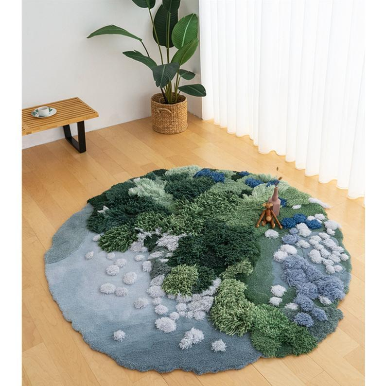 "<h2>TwopinsStore Moss Rug</h2><br>Moss and forest floor rugs are coveted items even outside of the ecology community. This Etsy shop offers different variations of earthy rugs from lakes to forests to tundras. <br><br><em>Shop</em> <strong><em><a href=""https://www.etsy.com/shop/TwopinsStore"" rel=""nofollow noopener"" target=""_blank"" data-ylk=""slk:TwopinsStore"" class=""link rapid-noclick-resp"">TwopinsStore</a></em></strong><br><br><strong>TwopinsStore</strong> Tundra/Forest/Mosses Rug, $, available at <a href=""https://go.skimresources.com/?id=30283X879131&url=https%3A%2F%2Fwww.etsy.com%2Flisting%2F913908142%2F3d-area-rugs-carpettundraforestmosses"" rel=""nofollow noopener"" target=""_blank"" data-ylk=""slk:Etsy"" class=""link rapid-noclick-resp"">Etsy</a>"