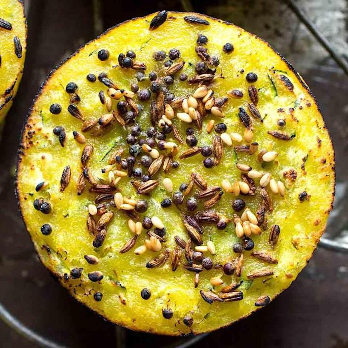 <p>Indian handvo are savory quick breads traditionally made with lauki (also called calabash), a large, mild squash found in India. In this healthy recipe, we use easier-to-find zucchini and bake them in a muffin tin so they all get delightfully crispy edges.</p>