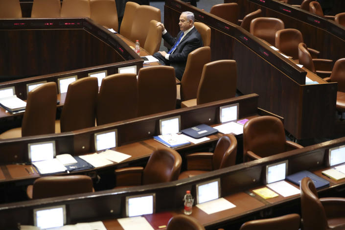 Outgoing Israeli Prime Minister Benjamin Netanyahu sits during a Knesset session in Jerusalem Sunday, June 13, 2021. Naftali Bennett is expected later Sunday to be sworn in as the country's new prime minister, ending Prime Minister Benjamin Netanyahu's 12-year rule. (AP Photo/Ariel Schalit)