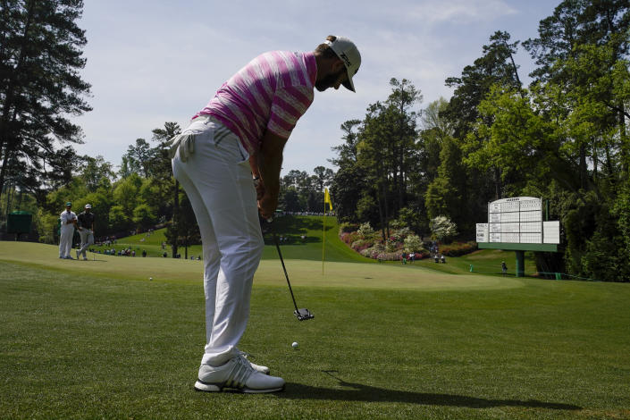 Dustin Johnson putts from off the sixth green during the first round of the Masters golf tournament on Thursday, April 8, 2021, in Augusta, Ga. (AP Photo/Charlie Riedel)