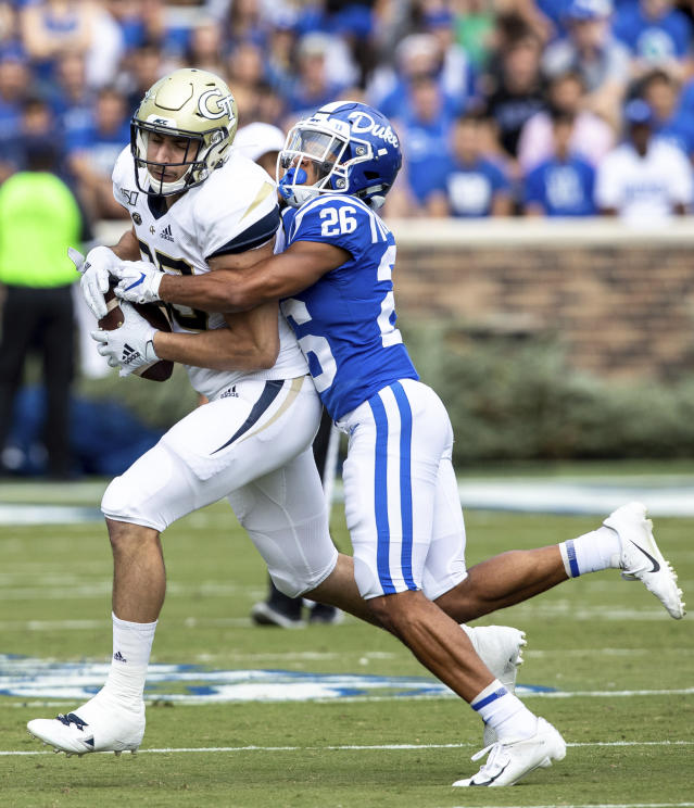 Georgia Tech's Tyler Davis, left, is tackled by Duke's Michael Carter II (26) during an NCAA college football game in Durham, N.C., Saturday, Oct. 12, 2019. (AP Photo/Ben McKeown)