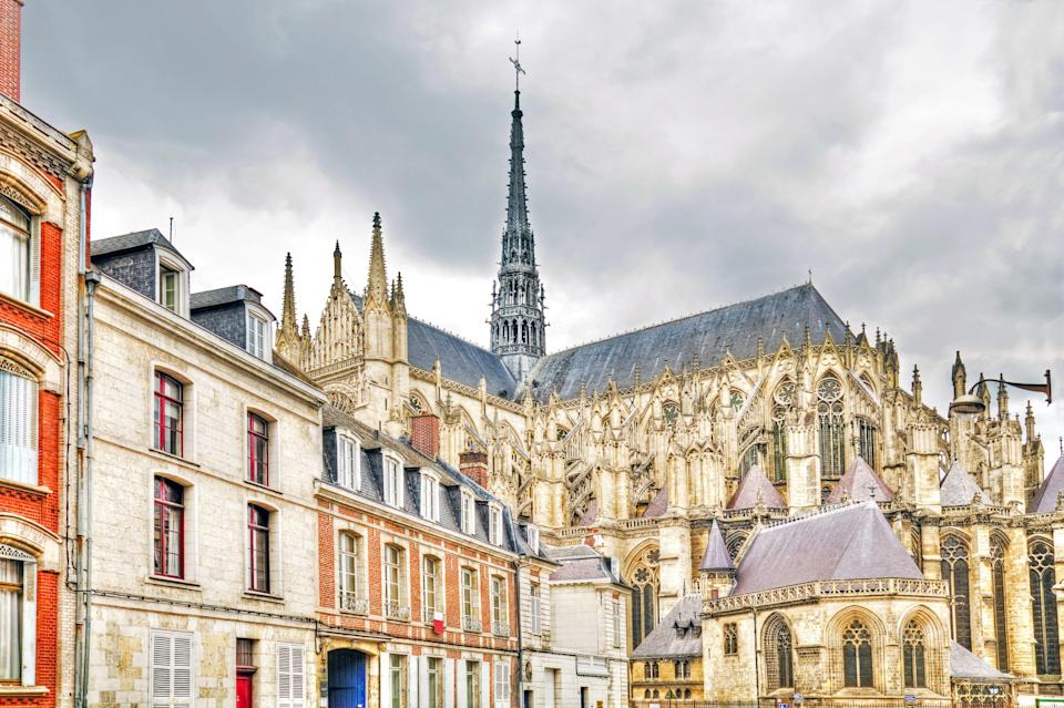 """<p><strong>Population:</strong> 132,874</p> <p>Its population might be a bit higher than some other towns on this list, but Amiens is still a charming and welcome respite from metropolitan Paris. (The town is about two hours north of the French capital by car.) While Amiens is primarily known for its stunning <a href=""""http://www.cntraveler.com/galleries/2016-03-24/the-most-beautiful-churches-in-france?mbid=synd_yahoo_rss"""" rel=""""nofollow noopener"""" target=""""_blank"""" data-ylk=""""slk:Gothic cathedral"""" class=""""link rapid-noclick-resp"""">Gothic cathedral</a>, you must also visit <em>les hortillonnages</em>, a series of floating gardens you can explore via small boats on the surrounding canals.</p>"""