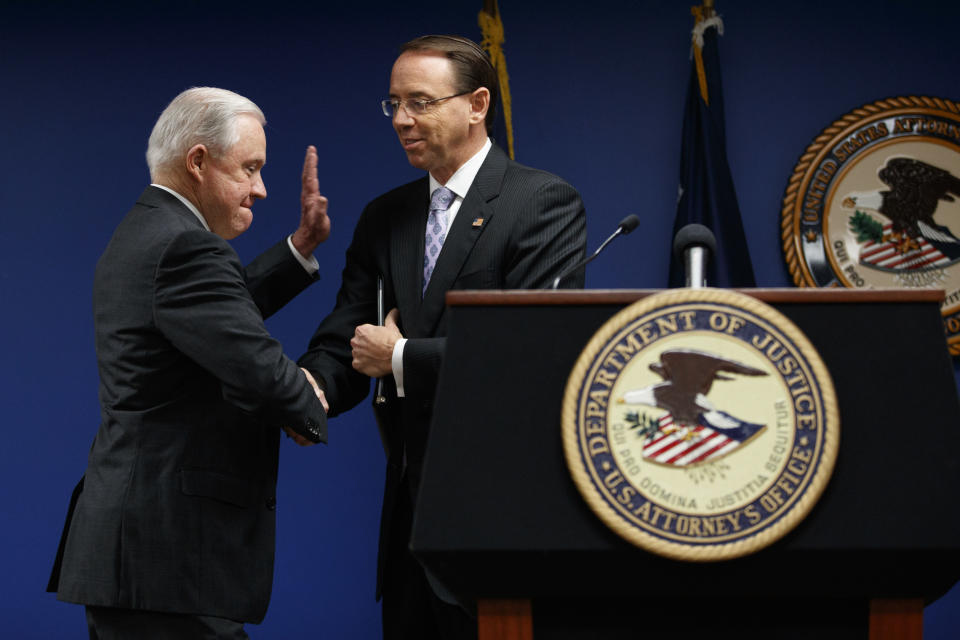 Attorney General Jeff Sessions and Deputy Attorney General Rod Rosenstein shake hands during a news conference at the U.S. Attorney's Office for the District of Columbia in Washington, Monday, Oct. 15, 2018, to announce on efforts to reduce transnational crime. (AP Photo/Carolyn Kaster)