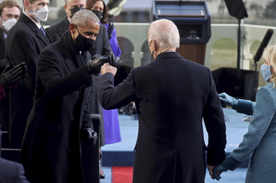 President-elect Joe Biden bumps fists with former President Barack Obama during Biden's inauguration, Wednesday, Jan. 20, 2021, at the U.S. Capitol in Washington./Pool Photo via AP)