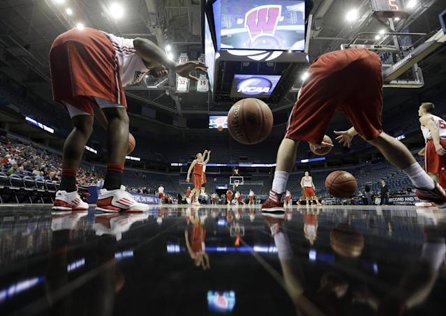 Wisconsin's Nigel Hayes, left, and Aaron Moesch dribble multiple balls as they warm up during a practice session for their NCAA college basketball tournament game Wednesday, March 19, 2014, in Milwaukee. Wisconsin plays American on Thursday, March 20, 2014. (AP Photo/Morry Gash)