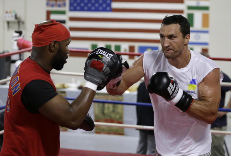 Undefeated heavyweight boxing champion Wladimir Klitschko, of Ukraine, right, trains with sparring partner Jonathon Banks, left, at the Lucky Street Boxing Gym, Thursday, March 20, 2014, in Hollywood, Fla. Klitschko is preparing for his upcoming fightApril 26 against Alex Leapai in Oberhausen, Germany. (AP Photo/Lynne Sladky)