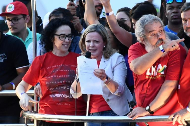 """Today is a very important date. We came here to register comrade Lula's candidacy despite those who didn't want it to happen,"" said Gleisi Hoffmann (center), head of the Workers' Party founded by Lula"