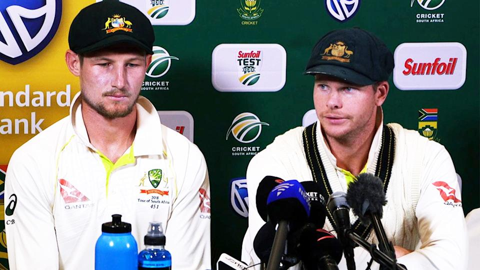 Cameron Bancroft (pictured left) and Steve Smith (pictured right) looking dejected facing the media.