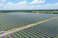 Solar panels are seen in this drone photo at the Impact solar facility in Deport, Texas