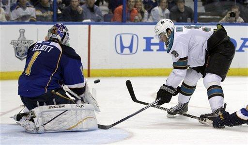 San Jose Sharks' Martin Havlat, of the Czech Republic, cannot reach the puck as St. Louis Blues goalie Brian Elliott, left, makes a stop during the third period in Game 2 of an NHL Stanley Cup first-round hockey playoff series Saturday, April 14, 2012, in St. Louis. The Blues won 3-0. (AP Photo/Jeff Roberson)