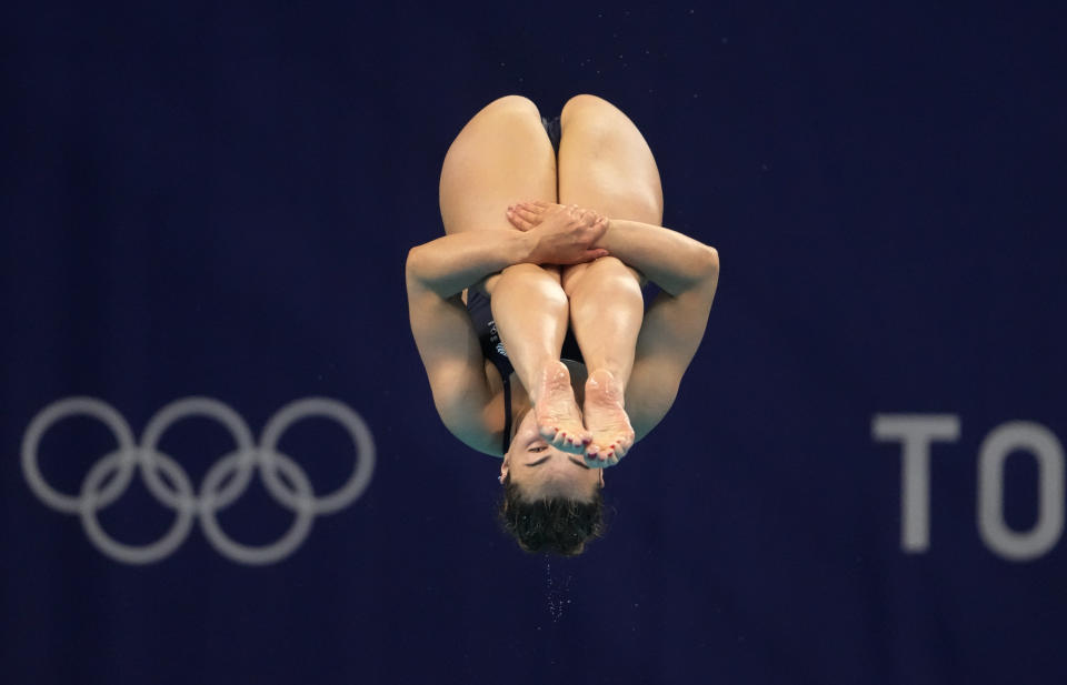 Scarlett Mew Jensen of Britain competes in women's diving 3m springboard preliminary at the Tokyo Aquatics Centre at the 2020 Summer Olympics, Friday, July 30, 2021, in Tokyo, Japan. (AP Photo/Dmitri Lovetsky)