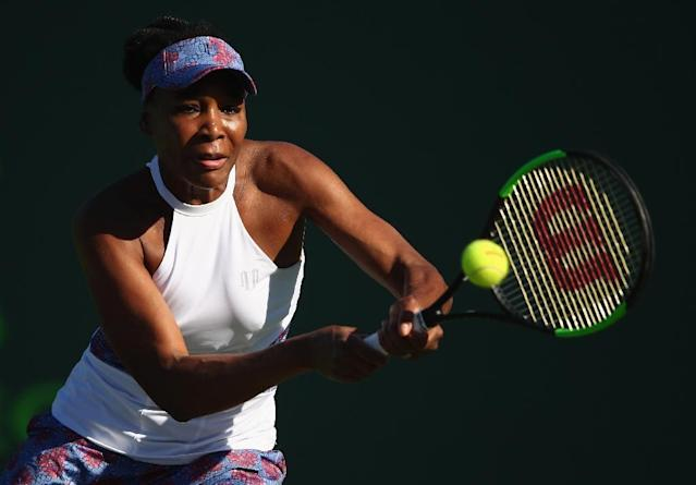 Venus Williams of the United States plays a backhand against Natalia Vikhlyantseva of Russia in their second round match during the Miami Open Presented by Itau at Crandon Park Tennis Center on March 23, 2018 in Key Biscayne, Florida (AFP Photo/CLIVE BRUNSKILL)
