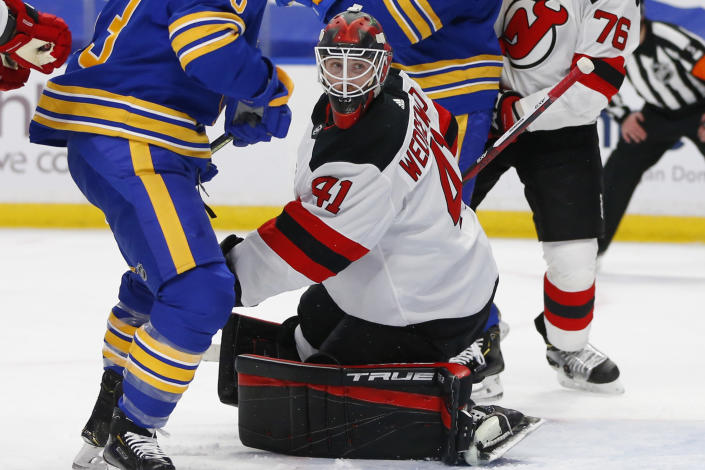 CORRECTS ID TO SCOTT WEDGEWOOD (41), NOT MACKENZIE BLACKWOOD (29) - New Jersey Devils goalie Scott Wedgewood (41) makes a save during the second period of an NHL hockey game against the Buffalo Sabres, Saturday, Jan. 30, 2021, in Buffalo, N.Y. (AP Photo/Jeffrey T. Barnes)