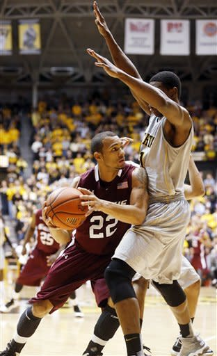Southern Illinois' Jeff Early (22) gets pressured by Wichita State's Cleanthony Early, right, during the second half of their NCAA college basketball game, Wednesday, Jan. 9, 2013, in Wichita, Kan. Wichita State won 82-76. (AP Photo/The Wichita Eagle, Fernando Salazar)