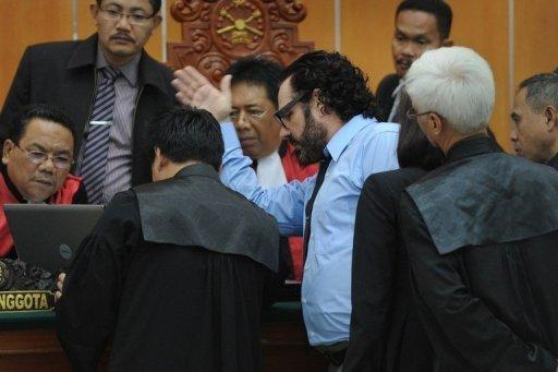 American Bali bombing survivor Stephen Cabler (C, in blue shirt) talks to a panel of Indonesian judges as he testifies in the trial of Muslim militant and suspected Bali bomber Umar Patek in Jakarta on April 5. Australian and US survivors of the 2002 Bali attacks relived the horror of seeing burning victims and their friends killed as they testified