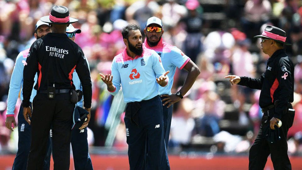 Adil Rashid (pictured middle) speaks to the umpires as Rassie van der Dussen is given not out on review during the 3rd One Day International match between England and South Africa on February 09, 2020 in Johannesburg, South Africa. (Photo by Dan Mullan/Getty Images)