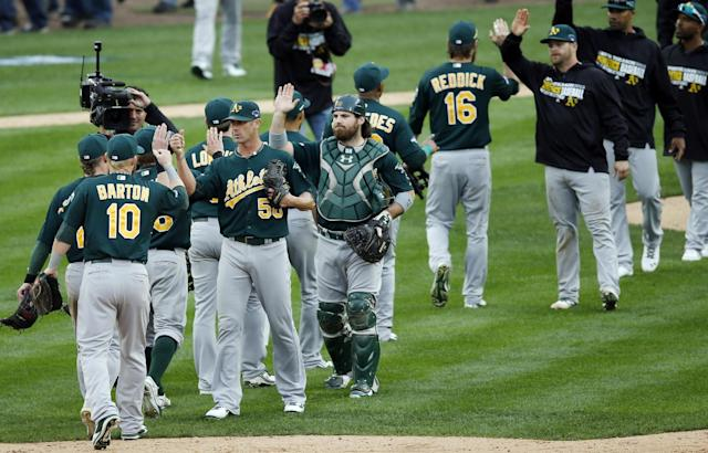 The Oakland Athletics celebrate their 6-3 win over the Detroit Tigers after Game 3 of an American League baseball division series in Detroit, Monday, Oct. 7, 2013. (AP Photo/Charles Rex Arbogast)