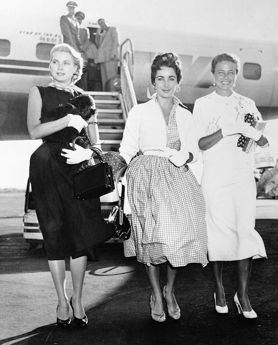 <p>In 1955, Kelly hops off of a TWA airplane upon her arrival in New York City. The actress flew from Los Angeles with fellow film stars Elizabeth Taylor and Lorraine Day.</p>