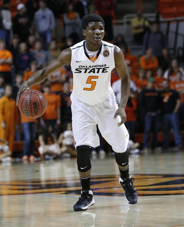 Oklahoma State guard Stevie Clark (5) is pictured during an NCAA college basketball game against Utah Valley in Stillwater, Okla., Tuesday, Nov. 12, 2013. Oklahoma State won 93-40. (AP Photo/Sue Ogrocki)