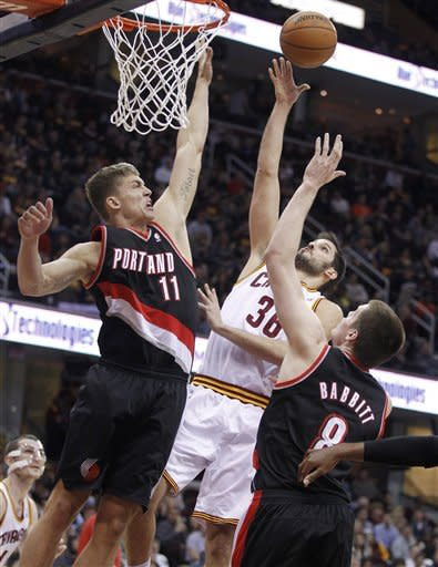 Cleveland Cavaliers' Omri Casspi (36), from Israel, shoots over Portland Trail Blazers' Meyers Leonard (11) and Luke Babbitt (8) in the second quarter of an NBA basketball game Saturday, Dec. 1, 2012, in Cleveland. (AP Photo/Tony Dejak)