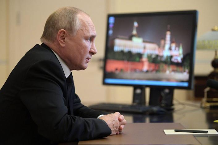 """<span class=""""caption"""">Vladimir Putin's anti-opposition tactics helped pull off the parliamentary win.</span> <span class=""""attribution""""><a class=""""link rapid-noclick-resp"""" href=""""https://www.gettyimages.com/detail/news-photo/russian-president-vladimir-putin-speaks-with-the-chair-of-news-photo/1235382705?adppopup=true"""" rel=""""nofollow noopener"""" target=""""_blank"""" data-ylk=""""slk:Alexey Druzhinin/SPUTNIK/AFP via Getty Images"""">Alexey Druzhinin/SPUTNIK/AFP via Getty Images</a></span>"""
