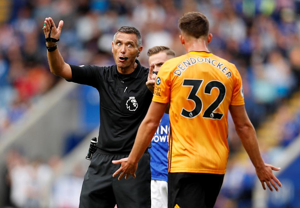 """Soccer Football - Premier League - Leicester City v Wolverhampton Wanderers - King Power Stadium, Leicester, Britain - August 11, 2019  Referee Andre Marriner gestures as Wolverhampton Wanderers' Leander Dendoncker reacts  Action Images via Reuters/John Sibley  EDITORIAL USE ONLY. No use with unauthorized audio, video, data, fixture lists, club/league logos or """"live"""" services. Online in-match use limited to 75 images, no video emulation. No use in betting, games or single club/league/player publications.  Please contact your account representative for further details."""