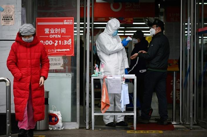 The virus has rapidly spread across the world over the past week (AFP Photo/STR)