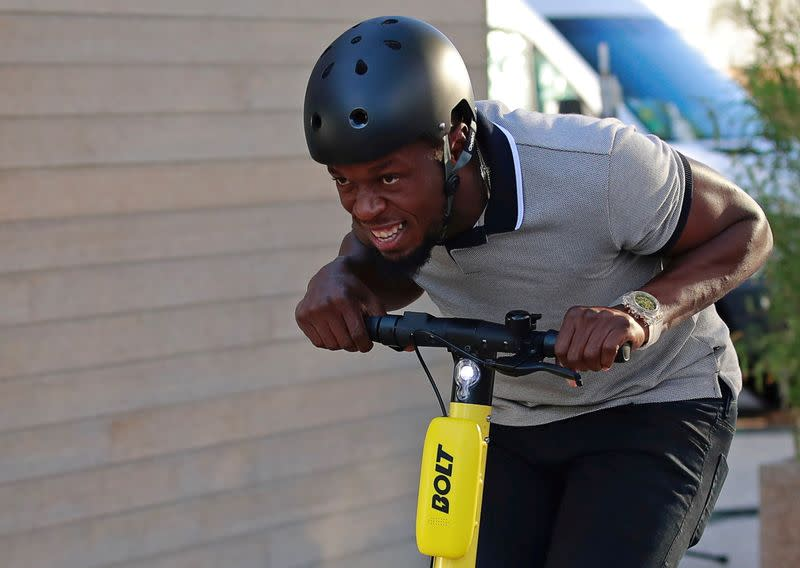 FILE PHOTO: Former sprinter Usain Bolt rides an electric scooter during the international launching of Bolt Electric Scooters by Bolt Mobility in Paris