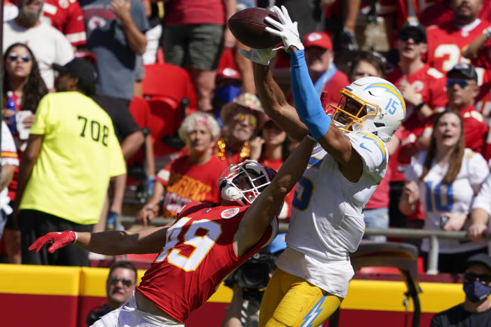 Kansas City Chiefs' Daniel Sorensen (49) breaks up a pass intended by Los Angeles Chargers' Jalen Guyton (15) during the first half of an NFL football game, Sunday, Sept. 26, 2021, in Kansas City, Mo. (AP Photo/Ed Zurga)