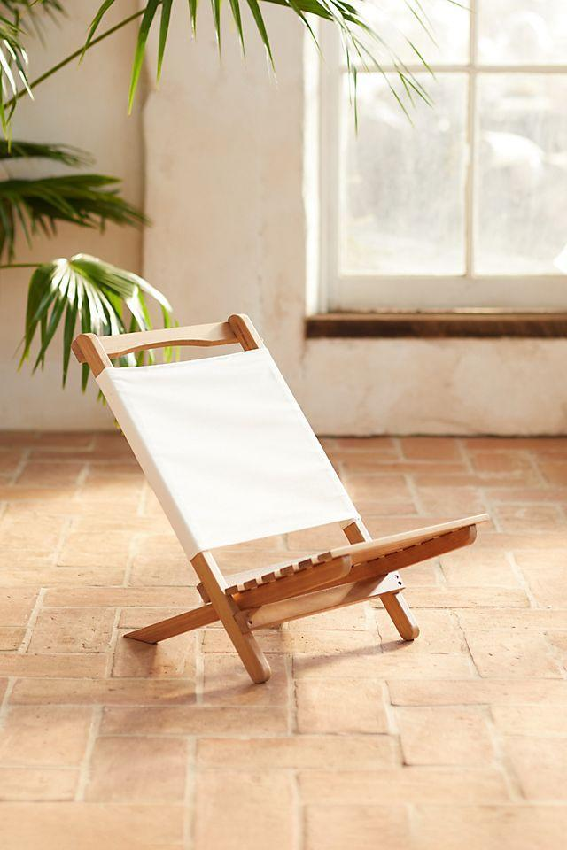 """<h2>Anthropologie Two Piece Portable Teak Lounge Chair</h2><br>Anthropologie is where style meets comfort — this UV coated umbrella canvas lounger is perfect for lakes, sandy beaches, or even just your backyard. <br><br><em>Shop</em> <strong><em><a href=""""http://anthropologie.com"""" rel=""""nofollow noopener"""" target=""""_blank"""" data-ylk=""""slk:Anthropologie"""" class=""""link rapid-noclick-resp"""">Anthropologie</a></em></strong><br><br><br><strong>Terrain</strong> Two Piece Portable Teak Lounge Chair, $, available at <a href=""""https://go.skimresources.com/?id=30283X879131&url=https%3A%2F%2Fwww.anthropologie.com%2Fshop%2Ftwo-piece-portable-teak-lounge-chair"""" rel=""""nofollow noopener"""" target=""""_blank"""" data-ylk=""""slk:Anthropologie"""" class=""""link rapid-noclick-resp"""">Anthropologie</a>"""