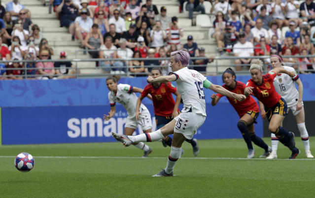 United States'Megan Rapinoe scores a scores the opening goal from a penalty spot during the Women's World Cup round of 16 soccer match between Spain and US at the Stade Auguste-Delaune in Reims, France, Monday, June 24, 2019. (AP Photo/Alessandra Tarantino)