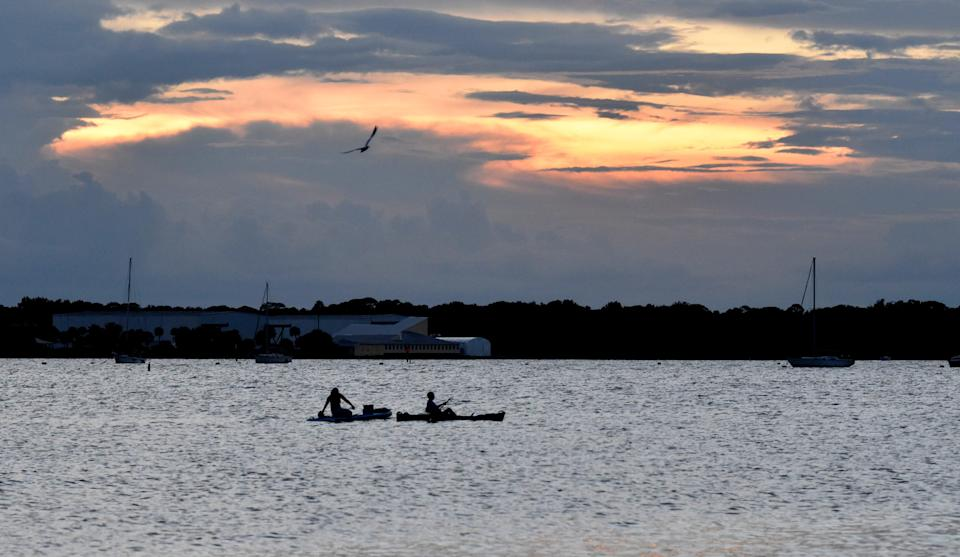 Spectators along the Indian River Lagoon in Titusville, Florida, wait for the launch of the SpaceX Falcon 9 rocket.