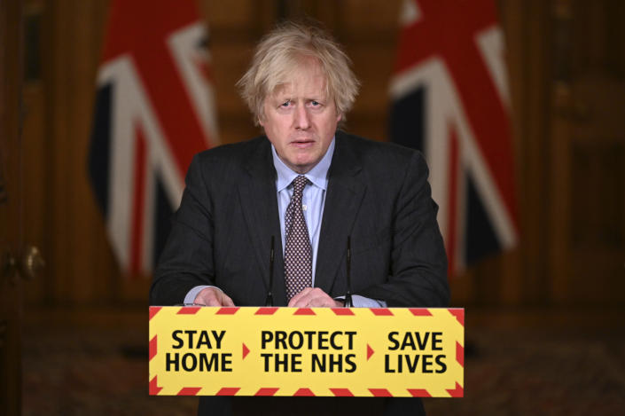 Britain's Prime Minister Boris Johnson speaks during a televised press conference at 10 Downing Street in London, Monday, Feb. 22, 2021. Johnson has announced a gradual easing of one of Europe's strictest lockdowns, saying children will return to class and people will be able to meet a friend for coffee in a park in two weeks' time. But people longing for a haircut, a restaurant meal or a pint in a pub have almost two months to wait, and people won't be able to hug loved ones that they don't live with until May at the earliest. (Leon Neal/Pool Photo via AP)