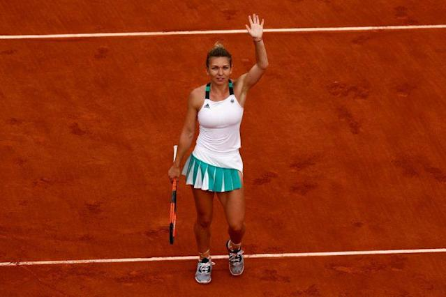 Romania's Simona Halep waves after her French Open semifinal win against Karolina Pliskova. (Getty Images)