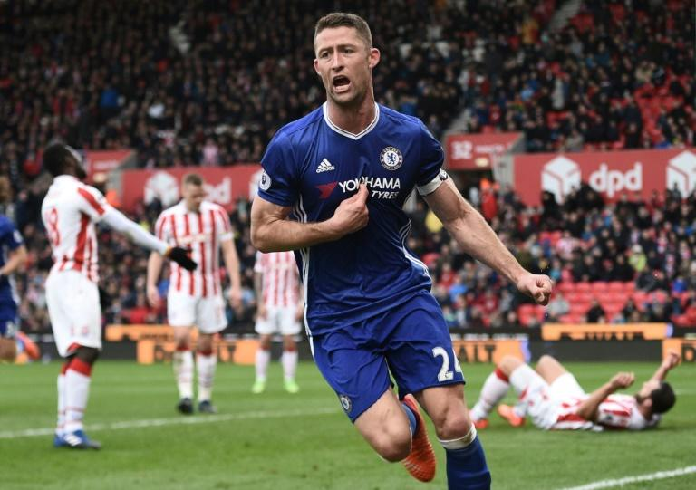 Chelsea's Gary Cahill (C) celebrates after scoring a goal during their English Premier League match against Stoke City, at the Bet365 Stadium in Stoke-on-Trent, on March 18, 2017