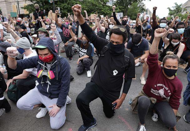PHOTO: Demonstrators kneel and raise their fists during a protest against police brutality and the death of George Floyd, June 2, 2020 in Washington, D.C. (Alex Wong/Getty Images)