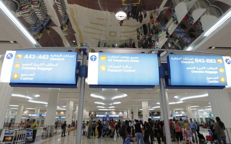 Travellers are seen at the Emirates terminal at Dubai International Airport