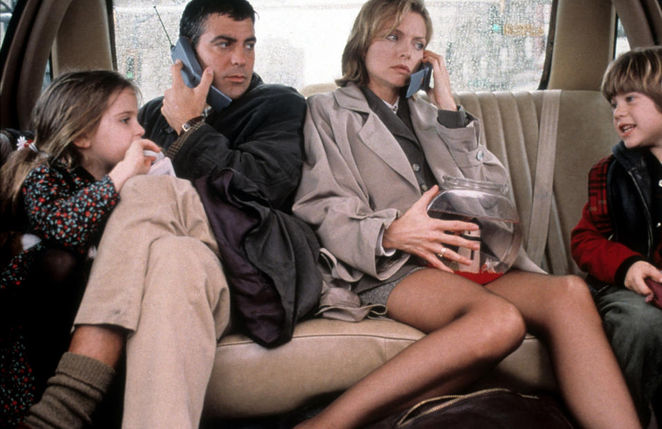 George Clooney and Michelle Pfeiffer on phones in backseat of car in a scene from the film 'One Fine Day', 1996. (Photo by 20th Century-Fox/Getty Images)
