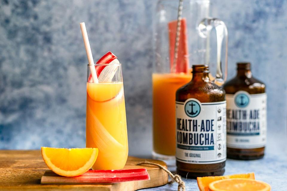 """<p><strong>Ingredients: </strong></p><p>Serves: 8 </p><p> 8 ounces water<br>2 ounces honey<br>2 cups rhubarb, sliced into ½"""" pieces<br>16 ounces all-natural orange juice<br>24 ounces Health-Ade The Original (1-1/3 bottles)<br>Orange wheels, for garnish<br>Rhubarb curls, for garnish<br></p><p><strong>Directions:</strong></p><p>To make rhubarb-infused water: add water, honey and rhubarb to a small saucepan set over medium heat. Lower to a gentle simmer and stir well. Simmer 5 minutes. Remove from the heat and let the rhubarb flavor infuse water, about 30 minutes. Strain into a mason jar and chill until cold. Pour chilled rhubarb water into a 50 oz pitcher. Add orange juice and Health-Ade. Stir with a long bar spoon. Garnish with orange wheels, if desired. Pour into chilled champagne flutes. Use a vegetable peeler to slice ribbons of rhubarb. Garnish each glass with a ribbon and serve.</p><p><em>Courtesy of <a href=""""https://health-ade.com/?gclid=EAIaIQobChMI6aGkwoLZ5AIVUuDICh2a7AFiEAAYASAAEgIhS_D_BwE"""" rel=""""nofollow noopener"""" target=""""_blank"""" data-ylk=""""slk:Health-Ade"""" class=""""link rapid-noclick-resp"""">Health-Ade</a></em><br> </p>"""