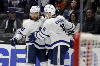 Toronto Maple Leafs' William Nylander, left, celebrates his goal with Zach Hyman (11) during the third period of an NHL hockey game against the Anaheim Ducks Friday, March 6, 2020, in Anaheim, Calif. (AP Photo/Marcio Jose Sanchez)