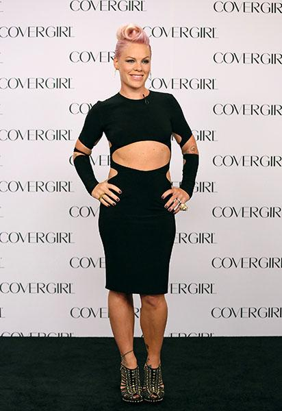 At her COVERGIRL announcement, Alecia Moore aka P!nk wowed in an LBD that was anything but standard. The cutouts are sexy without being trashy, but what we most love about this look (besides her fresh and feminine makeup) is her candy-pink retro pinup hairstyle.
