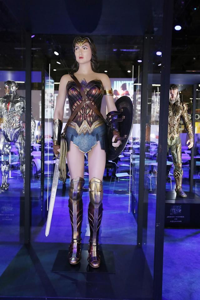 <p>Gal Gadot's star-spangled outfit — accessorized with tiara, golden lasso, sword, and shield — remains largely unchanged from <i>Batman v Superman</i> and <i>Wonder Woman</i>. (Credit: Warner Bros.) </p>