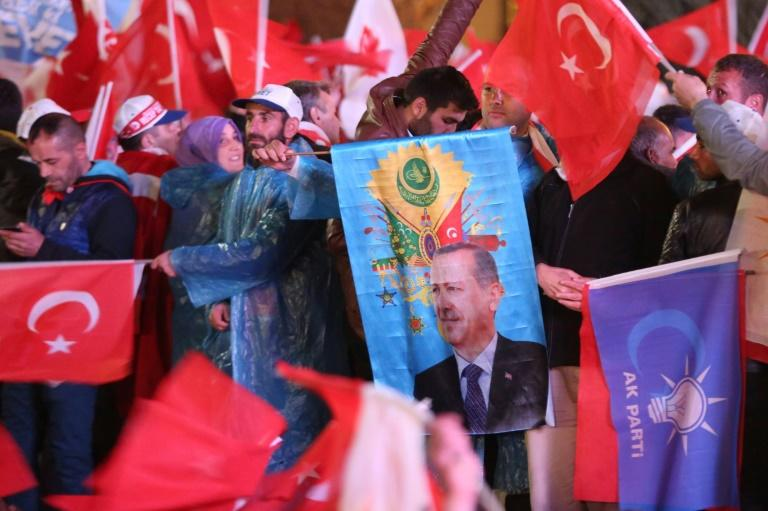 Crowds of jubilant supporters of Turkish President Recep Tayyip Erdogan celebrate as he claims victory in the referendum