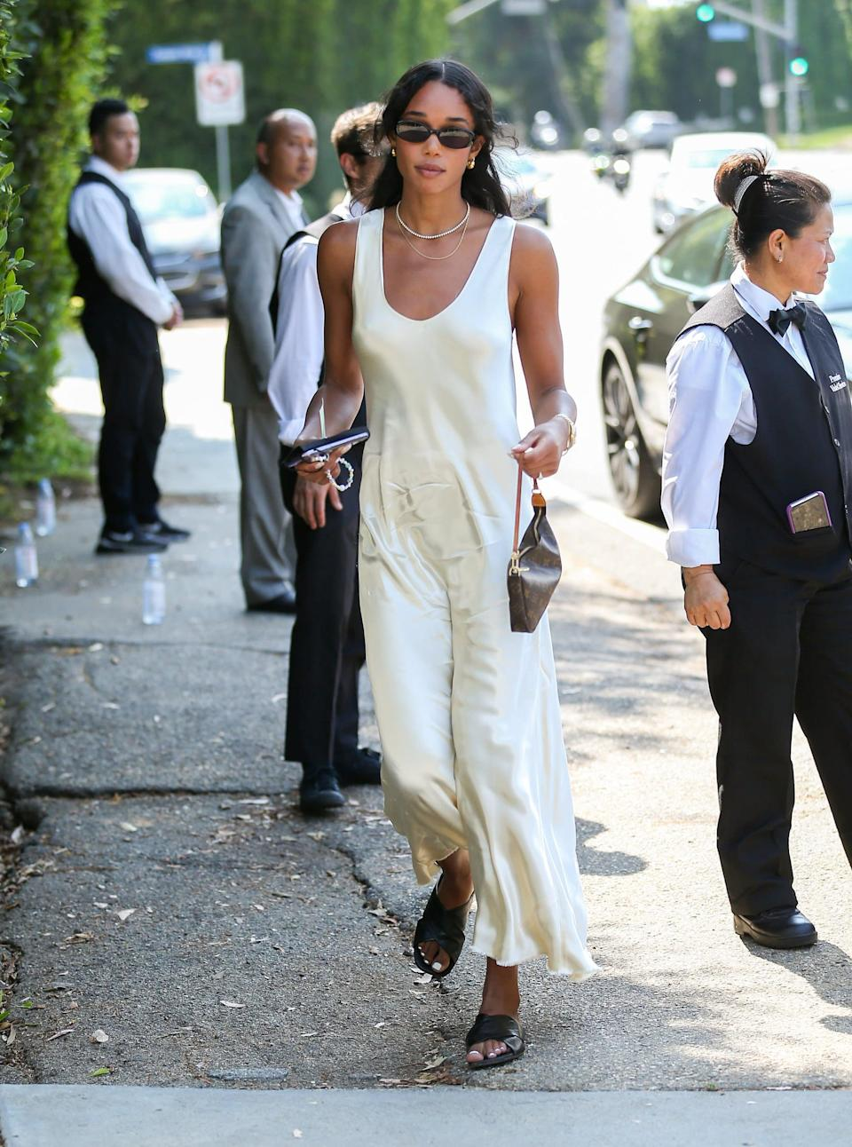 <p>Laura Harrier gave us a lesson in less-is-more dressing with this easy, breezy slip dress and slides. </p>