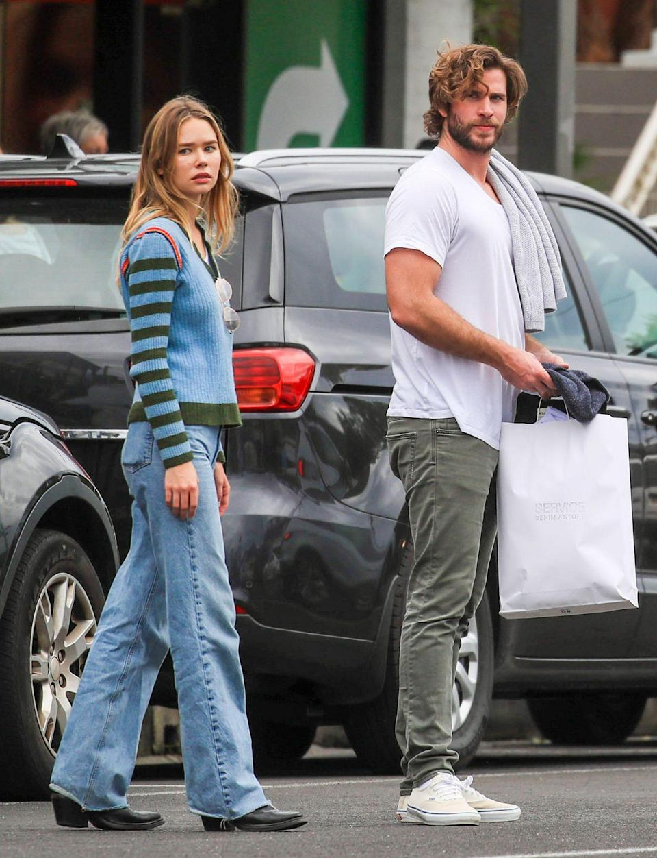 <p>Liam Hemsworth and Gabriella Brooks step out for groceries in Byron Bay, Australia on June 27. </p>