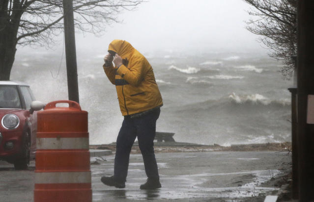 <p>A pedestrian walks near the coastline Friday, March 2, 2018, in Newburyport, Mass. as a major nor'easter pounds the East Coast, packing heavy rain, intermittent snow and strong winds. (Photo: Elise Amendola/AP) </p>