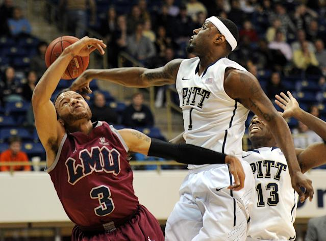 Pittsburgh forward Jamel Artis (1) blocks a shot by Loyola Marymount guard Anthony Ireland (3) during the first half of an NCAA college basketball game on Friday, Dec. 6, 2013, in Pittsburgh. (AP Photo/Don Wright)