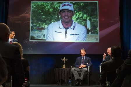Ryder Cup team U.S. captain Tom Watson smiles as he announces that Keegan Bradley (on screen) will be one of his three picks to add to this year's Ryder Cup squad during an event in New York September 2, 2014. REUTERS/Lucas Jackson
