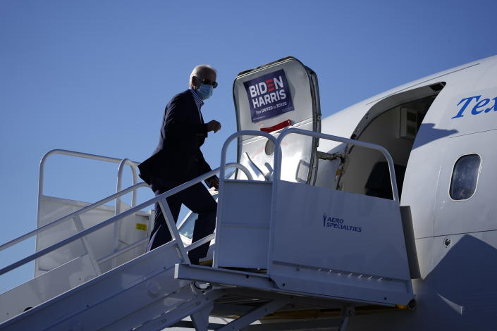 Democratic presidential candidate former Vice President Joe Biden boards his campaign plane at New Castle Airport in New Castle, Del., Thursday, Oct. 8, 2020., en route to Arizona. (AP Photo/Carolyn Kaster)